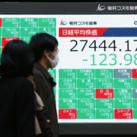 A monitor in Tokyo shows the 225-issue Nikkei stock average marking the highest year-end close since 1989 on Wednesday. | KYODO