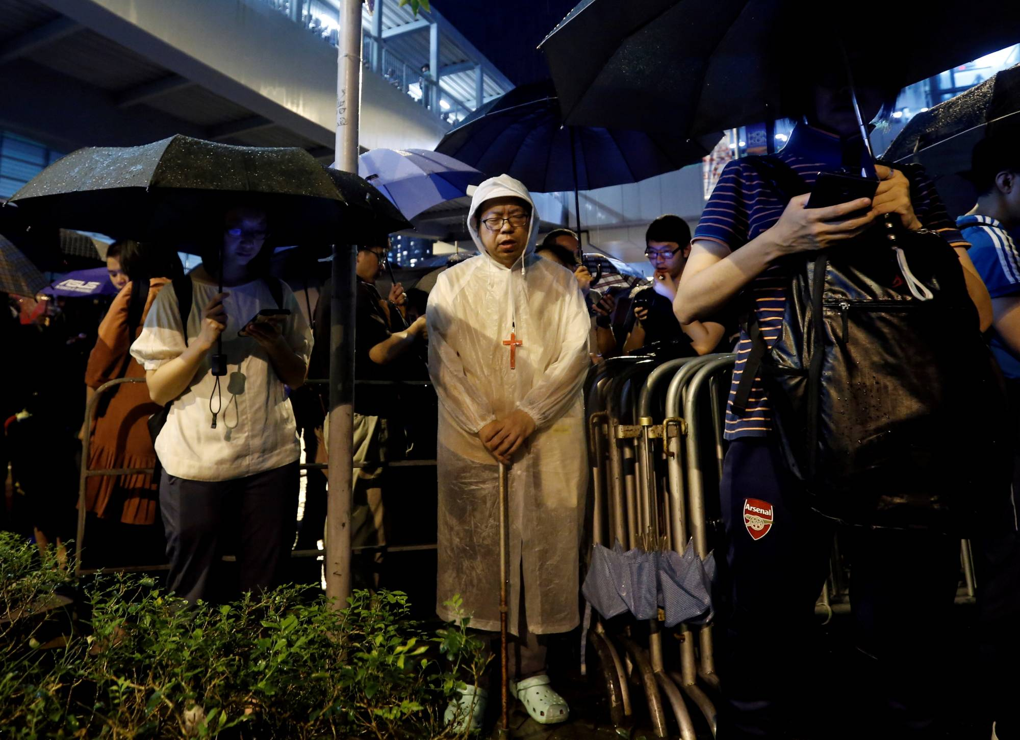 Worshipers attend a Catholic service outside the Legislative Council building as they protest a controversial extradition bill in Hong Kong in June 2019. | REUTERS