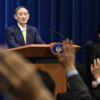 Prime Minister Yoshihide Suga speaks at a news conference on Friday.  | KYODO