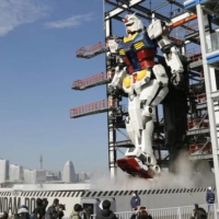 A life-size moving statue of Gundam is shown to the media Monday at Yamashita Pier in Yokohama.  | KYODO