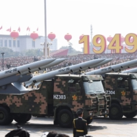 Military vehicles carrying HHQ-9B surface-to-air missiles participate in a military parade at Tiananmen Square in Beijing on Oct. 1, 2019, to mark the 70th anniversary of the founding of the People's Republic of China. | AFP-JIJI