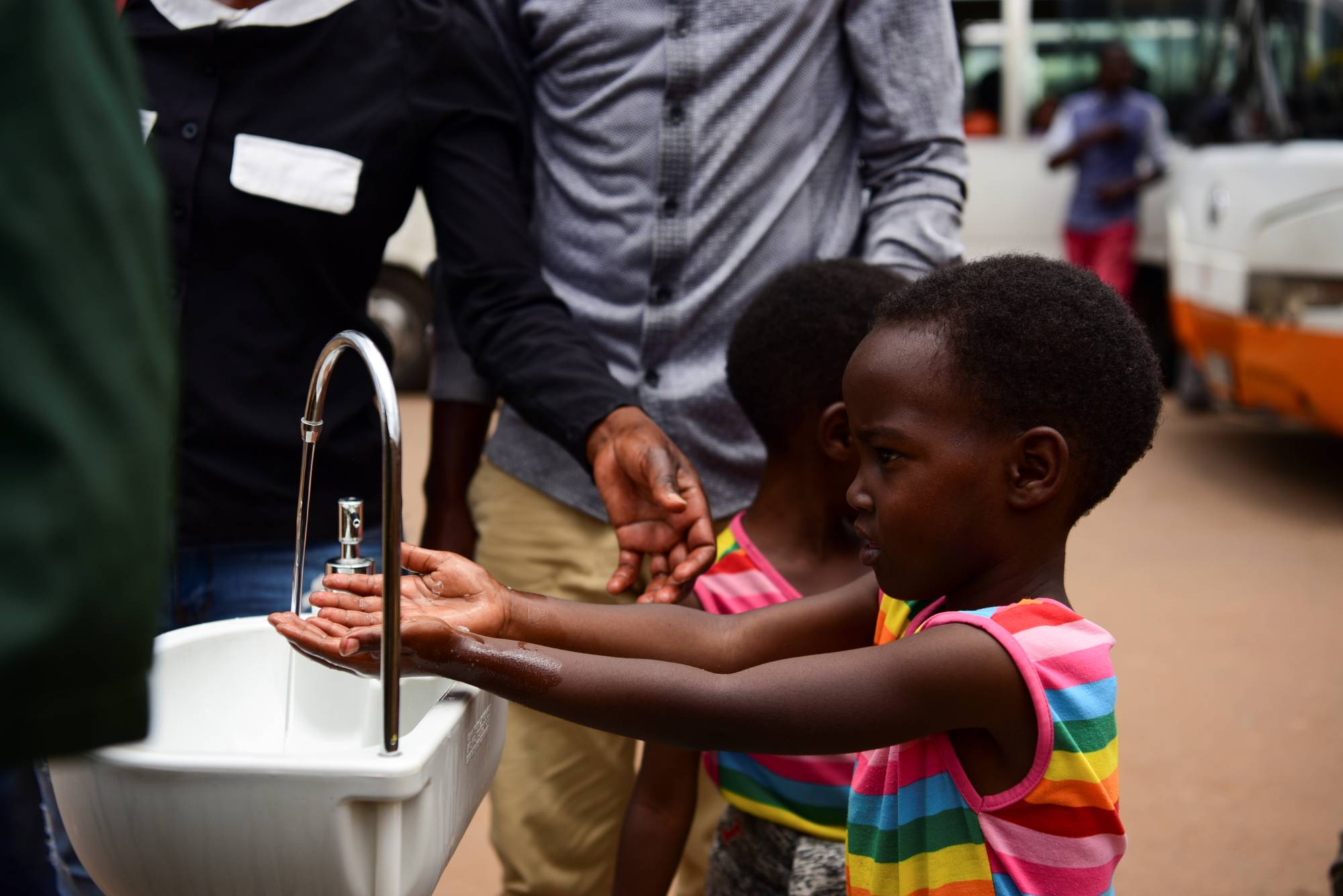 A girl washes her hands at a public hand washing station as a cautionary measure against the coronavirus at Nyabugogo Bus Park in Kigali, Rwanda, on March 11. | REUTERS