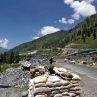 Indian Border Security Force soldiers stand guard at a checkpoint along a highway leading to Ladakh, at Gagangeer, in Kashmir's Ganderbal district, in June 2019. | REUTERS