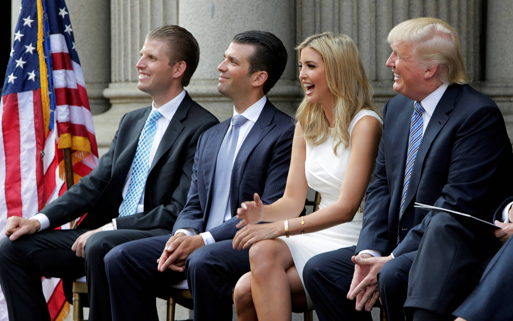 (Left to right) Eric Trump, Donald Trump Jr., Ivanka Trump and Donald Trump attend the ground breaking of the Trump International Hotel in Washington in July 2014.  | REUTERS