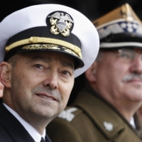 Adm. James Stavridis, NATO's then-supreme commander and Poland's chief of defense, attend a ceremony in Lodz, Poland, in November 2012.    | REUTERS