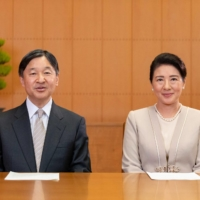 Emperor Naruhito and Empress Masako speak during a New Year's video message at the Akasaka Estate residence in Tokyo on Thursday.   | IMPERIAL HOUSEHOLD AGENCY OF JAPAN / VIA AFP-JIJI
