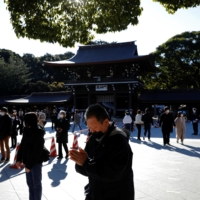 People pray on New Year's Day at Meiji Shrine in Tokyo. | REUTERS