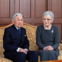 Emperor Emeritus Akihito and Empress Emerita Michiko pose for a photograph during a family photo session for the New Year at their residence in Tokyo on Dec. 2.  | IMPERIAL HOUSEHOLD AGENCY / VIA REUTERS