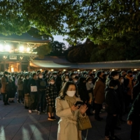 People offer prayers at Meiji Shrine in Tokyo on New Year's Day. Tokyo reported 841 new COVID-19 cases on Saturday amid an uptick in the number of infections. | AFP-JIJI