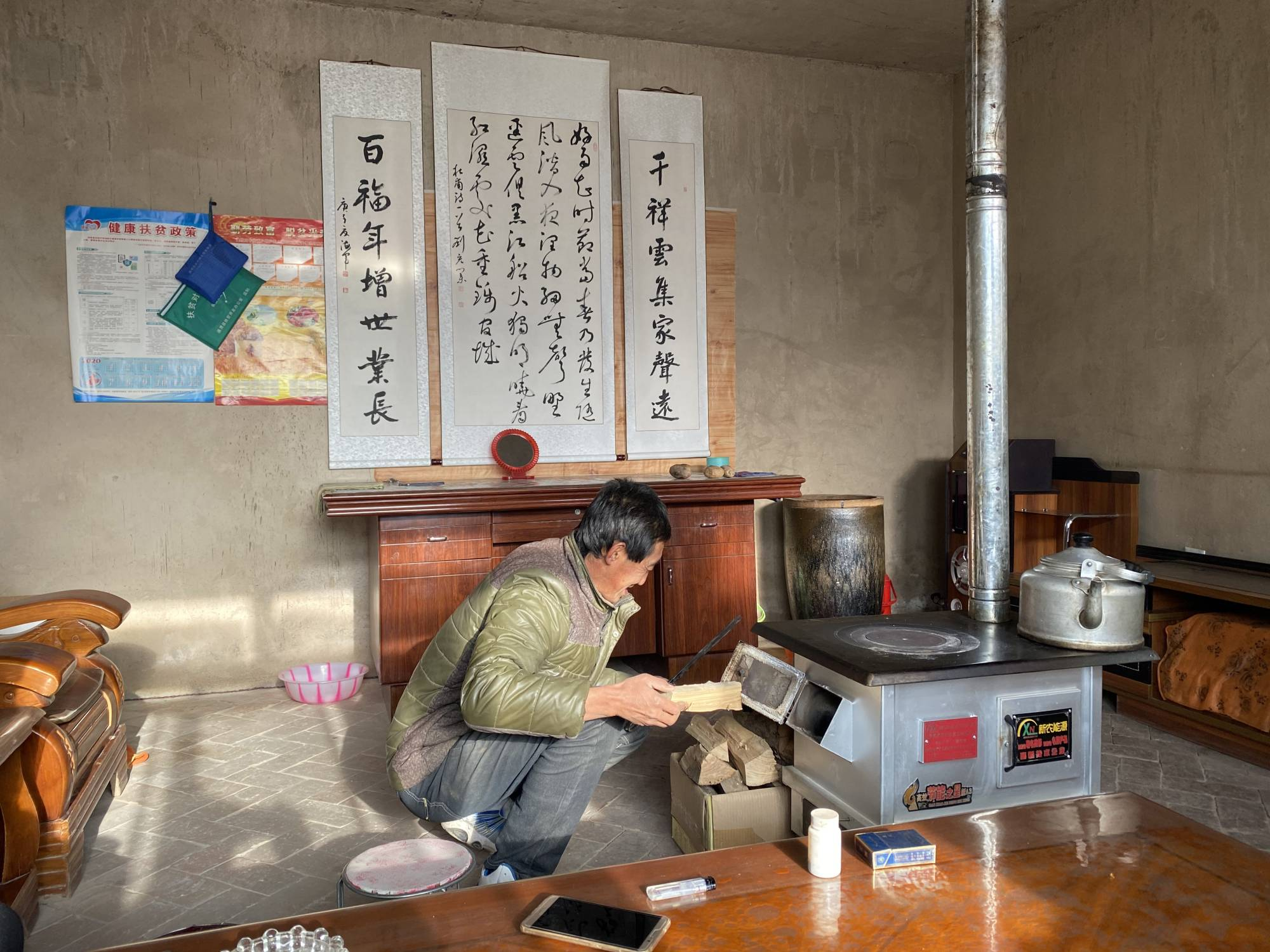 Su Zizhen, who lives in China's Gansu Province, received a home from from a poverty alleviation program. | KEITH BRADSHER / THE NEW YORK TIMES