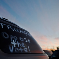 '#Trump Oppose The Vote' is written on a car window at Republican Sen. Kelly Loeffler's 'Senate Firewall Statewide Tour' campaign stop in Canton, Georgia, on Sunday. | REUTERS