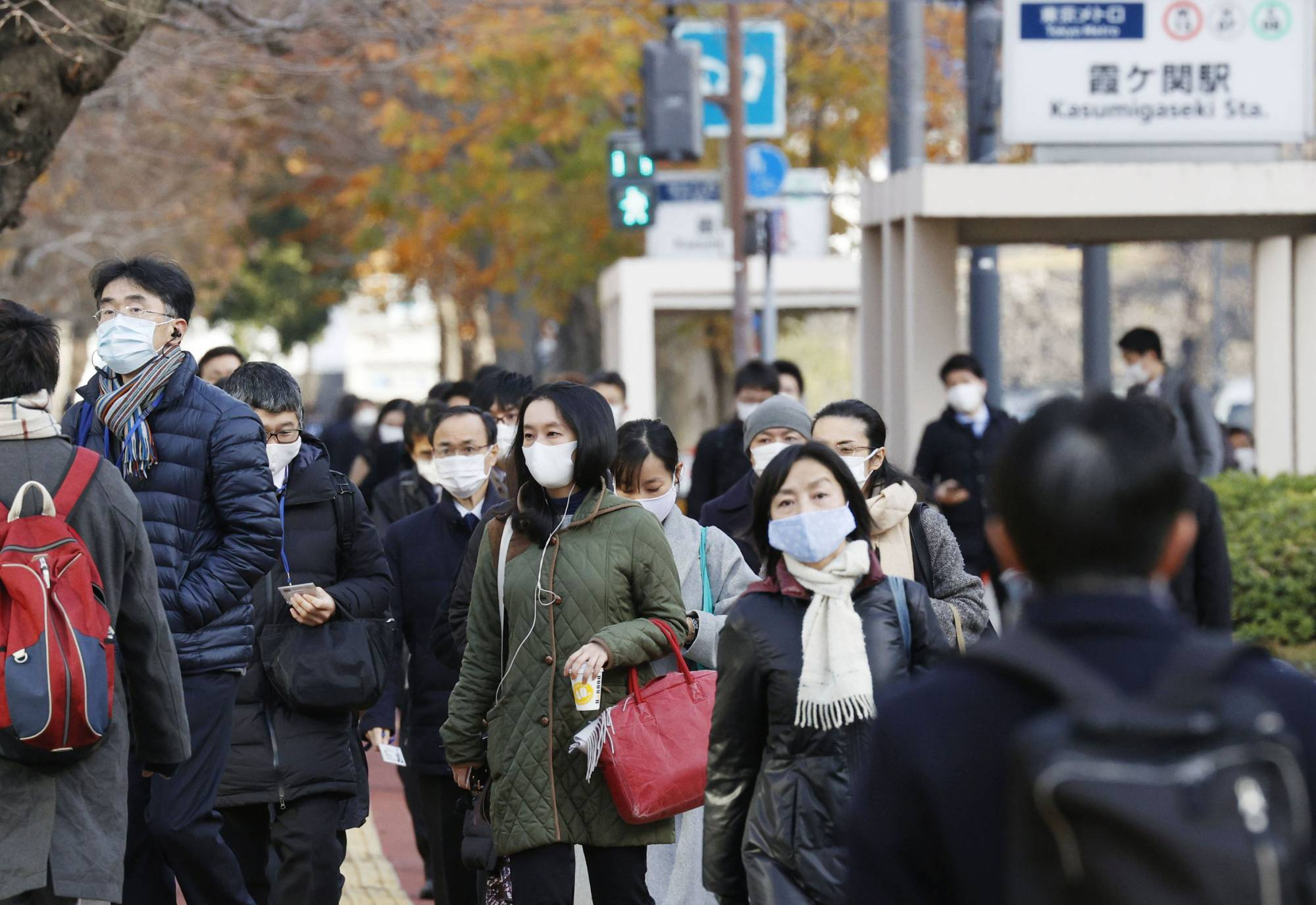 People walk to work in Tokyo on Monday after the New Year's holidays. Economists expect consumption to recover toward the end of this year if COVID-19 vaccinations become available for widespread use by summer. | KYODO