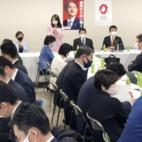 Liberal Democratic Party lawmakers discuss at a meeting in Tokyo on Dec. 8 whether to enable married couples to have separate surnames. | KYODO