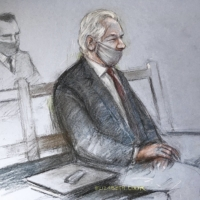 A court sketch of Julian Assange attending the ruling in his extradition case on Monday at the Old Bailey in London | ELIZABETH COOK / PA VIA AP
