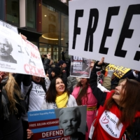 People celebrate outside the Old Bailey in London after a judge ruled Monday that WikiLeaks founder Julian Assange should not be extradited to the U.S. |  REUTERS