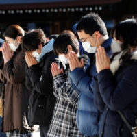 The number of visitors to shrines and temples in the first three days of the new year plummeted from the same period a year before. | REUTERS