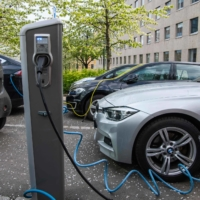 Electric cars being charged on a street in Oslo on April 30, 2019. | AFP-JIJI
