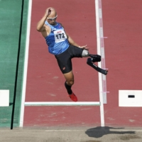 Atsushi Yamamoto competes in the men's T63 long jump event during the para athletics national championships in Kumagaya, Saitama Prefecture, on Sept. 5. | KYODO