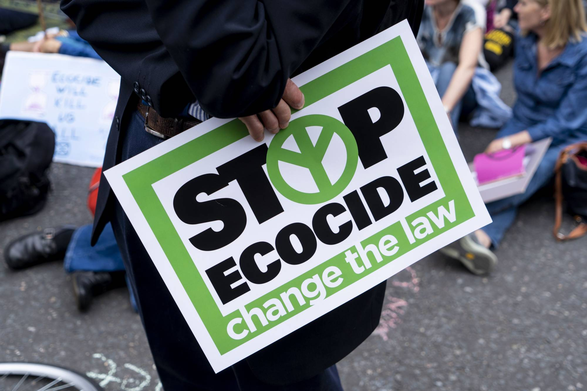 An Extinction Rebellion demonstrator protests outside of The Royal Courts of Justice in London in July 2019. | AFP-JIJI