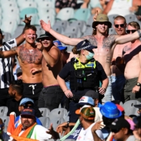 Police stand by as Australia fans heckle Indian supporters on the first day of the second cricket test between Australia and India at Melbourne Cricket Ground on Dec. 26 in Melbourne. | AFP-JIJI