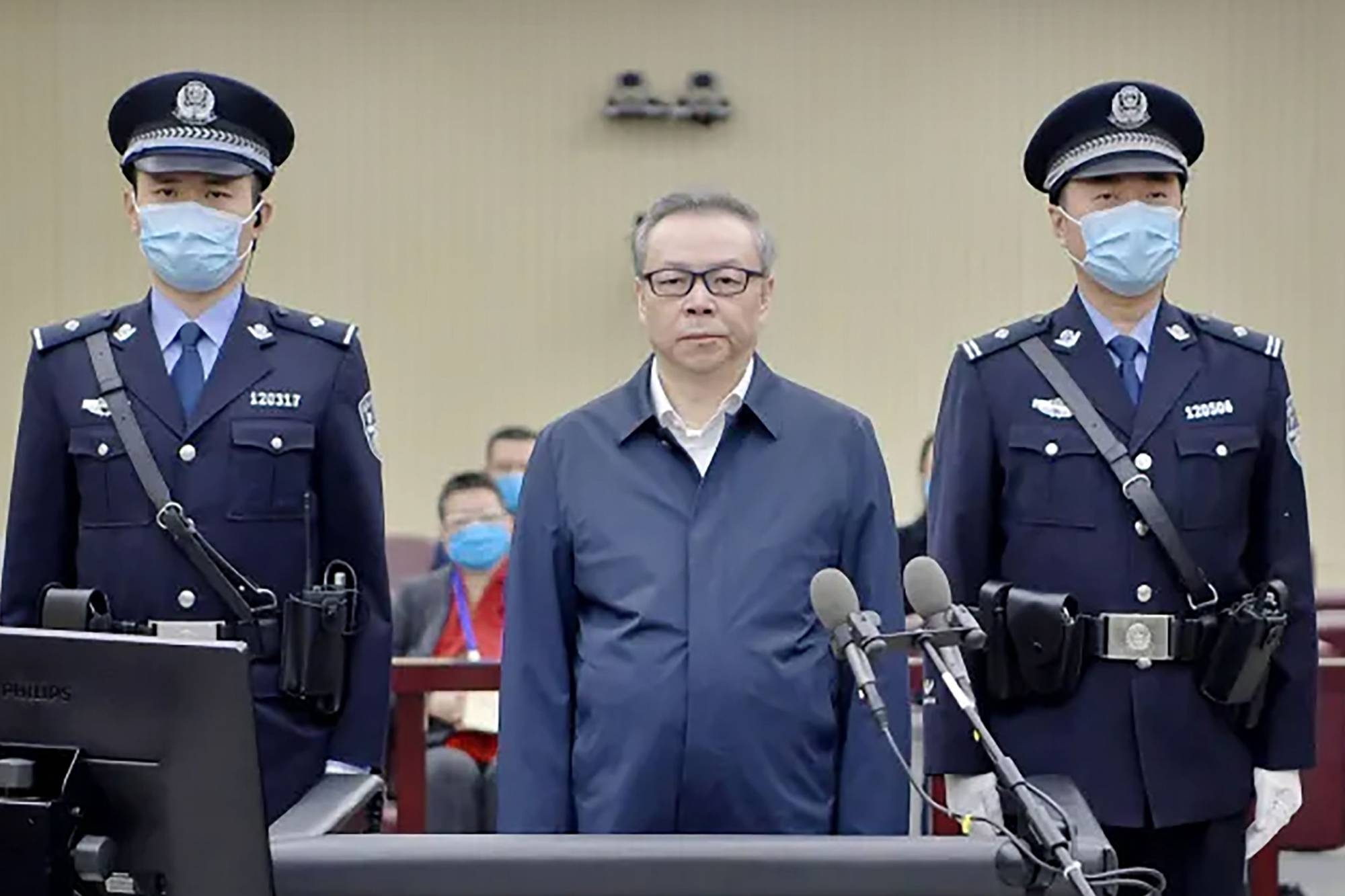 Lai Xiaomin (center), the former chairman of China Huarong Asset Management Co., was sentenced to death on Tuesday for soliciting $277 million in bribes as well as bigamy. | SECOND INTERMEDIATE PEOPLE COURT OF TIANJIN / VIA AFP-JIJI