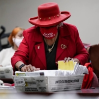 A DeKalb County election worker sorts empty absentee ballot envelopes following the U.S. Senate runoff elections in Decatur, Georgia, on Wednesday. | REUTERS