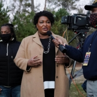 Stacey Abrams speaks to the media about the U.S. Senate runoff elections outside St. Paul's Episcopal Church in Atlanta on Tuesday.  | REUTERS