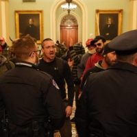 Members of a pro-Trump mob storm the Capitol building to disrupt the recording of Electoral College votes to confirm the victory of President-elect Joe Biden in Washington on Wednesday. | ERIN SCHAFF / THE NEW YORK TIMES