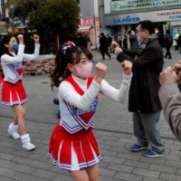 Cheerleaders lift Tokyo's spirits as coronavirus cases surge