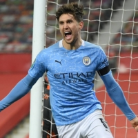 John Stones helps send Man City past United in League Cup semifinals