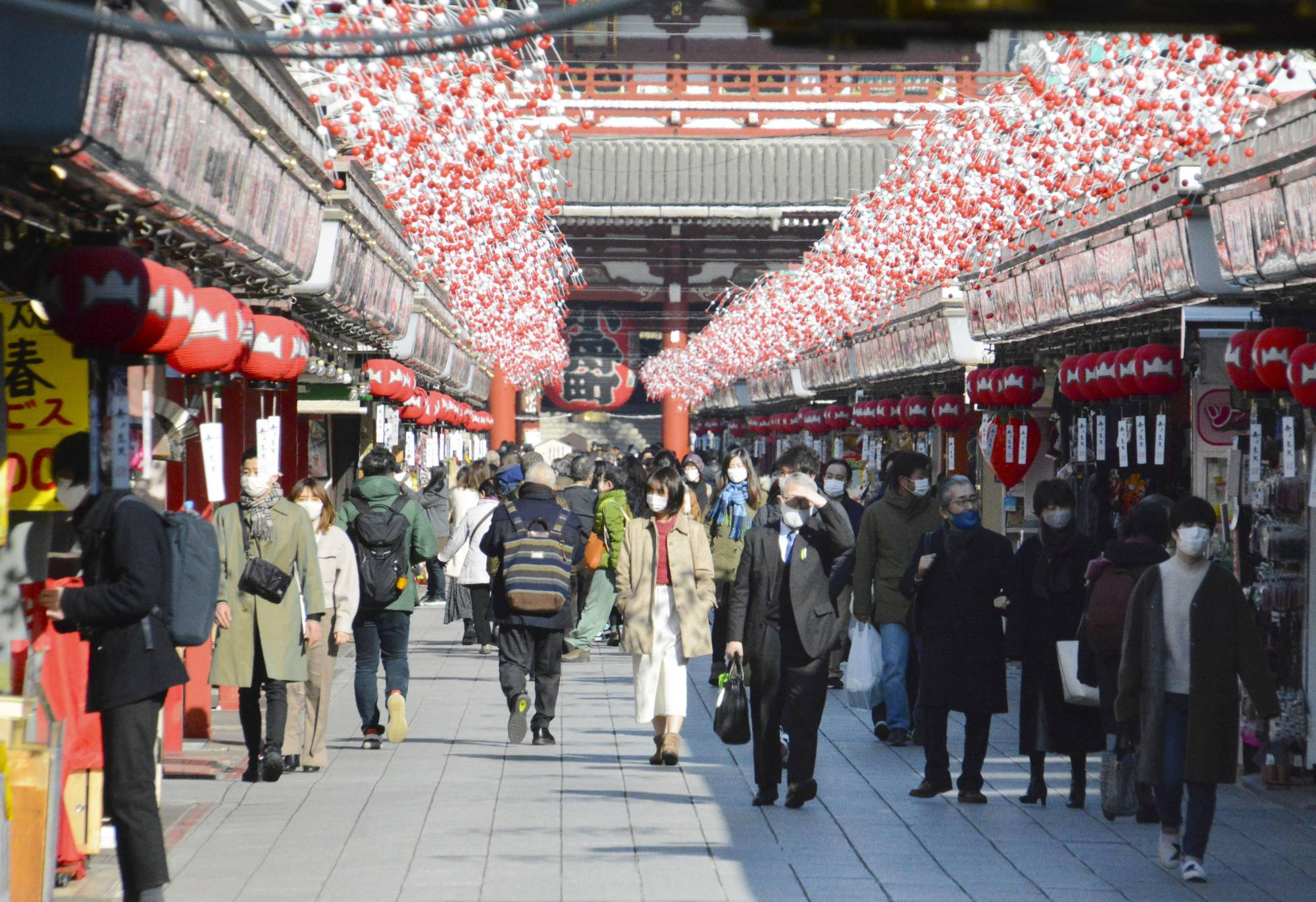 Less foot traffic than usual is seen in the Asakusa area of Tokyo on Thursday, but still more than in April when the previous state of emergency was imposed. | KYODO