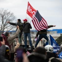 Demonstrators enter the U.S. Capitol after breaching security fencing during a protest in Washington, D.C., on Wednesday. One person was shot and died during the incident.  |  BLOOMBERG