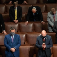 Republican members of Congress pray after U.S. Vice President Mike Pence declared the final Electoral College vote counts making Joe Biden the next U.S. President during a joint session of Congress at the Capitol in Washington on Thursday. | AFP-JIJI