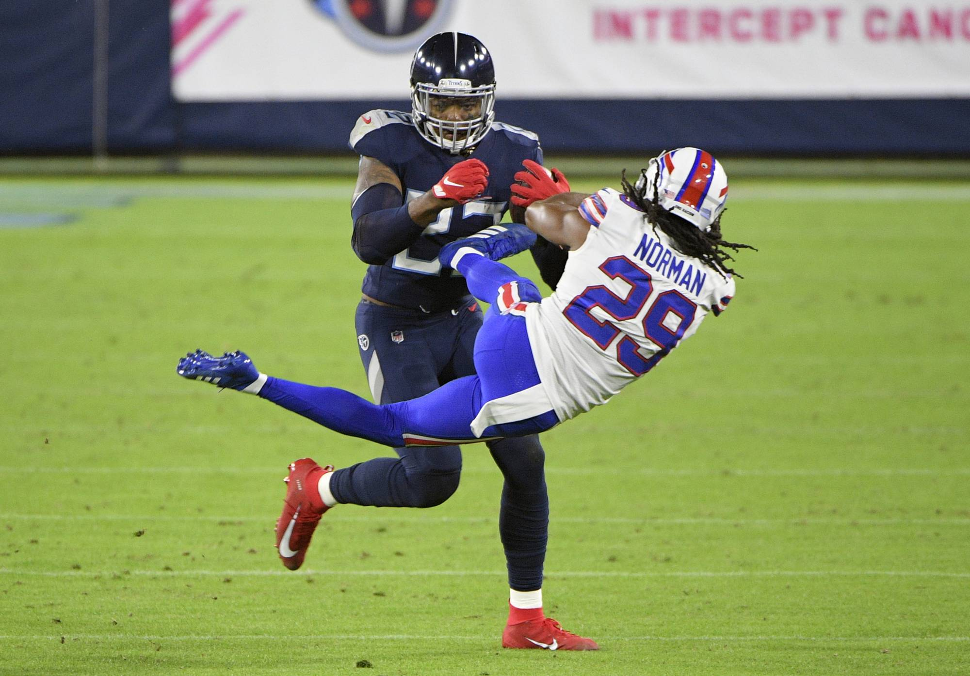 Titans running back Derrick Henry tosses aside Bills cornerback Josh Norman during their game in Nashville, Tennessee, on Oct. 13, 2020. | USA TODAY / VIA REUTERS