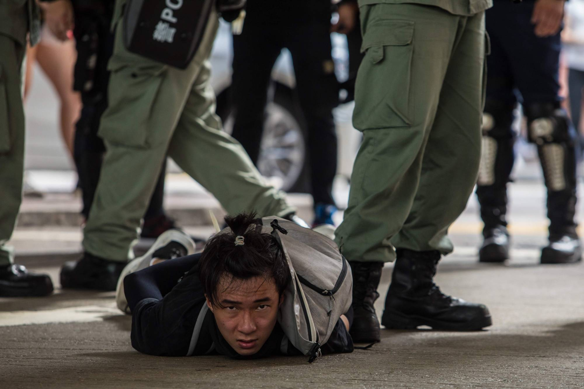 Riot police detain a man as they clear protesters taking part in a rally against a new national security law in Hong Kong on July 1, the 23rd anniversary of the city's handover from Britain to China and the day the new law came into effect. | AFP-JIJI