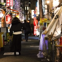 Foot traffic is low on a street lined with restaurants and bars in Tokyo's Shimbashi district on Thursday night. | KYODO