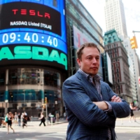 CEO of Tesla Motors Elon Musk poses during a television interview after his company's initial public offering on the NASDAQ market in New York in June 2010. | REUTERS