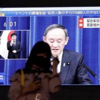 A live broadcast shows Prime Minister Yoshihide Suga declaring a state of emergency for Tokyo and three neighboring prefectures, amid the coronavirus outbreak, in the capital city on Thursday.    | REUTERS
