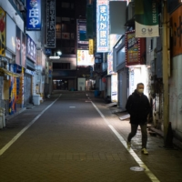 A street in Tokyo's Shibuya Ward on Friday. The monthlong state of emergency covering Tokyo, Kanagawa, Saitama and Chiba prefectures is less comprehensive than the previous one in April last year.   BLOOMBERG
