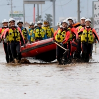 Rescue workers search a flooded area in the aftermath of Typhoon Hagibis, which caused severe floods at the Chikuma River in Nagano Prefecture in October 2019.   REUTERS