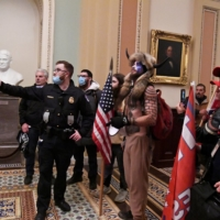 Police speak to supporters of U.S. President Donald Trump on the second floor of the U.S. Capitol after breaching security defenses in Washington on Wednesday.  | REUTERS
