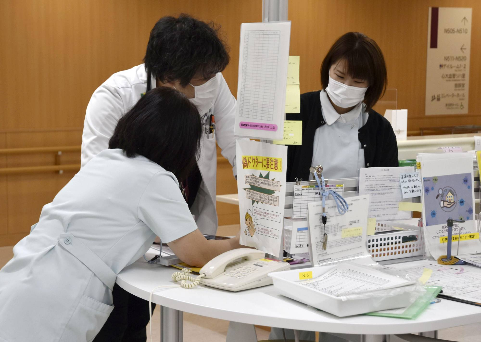 Staff at Tsuyama Chuo Hospital in Okayama Prefecture discuss the introduction of measures to deal with coronavirus patients on Dec. 25. | KYODO