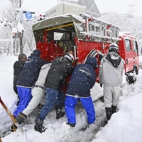 Motorists stranded and trains delayed as winter weather pummels Japan