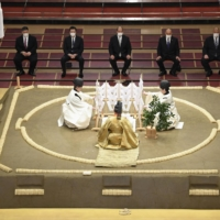 A ring purification ceremony is held on Saturday ahead of Sunday's start of the New Year Grand Sumo Tournament at Tokyo's Ryogoku Kokugikan. | KYODO