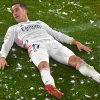 Real Madrid forward Lucas Vazquez lies on the ground during his team's Spanish first-division match against Osasuna on Saturday in Pamplona, Spain. | AFP-JIJI