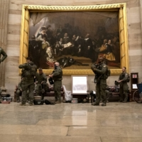 Police in riot gear sit in the rotunda of the U.S. Capitol in Washington on Wednesday.  | BLOOMBERG