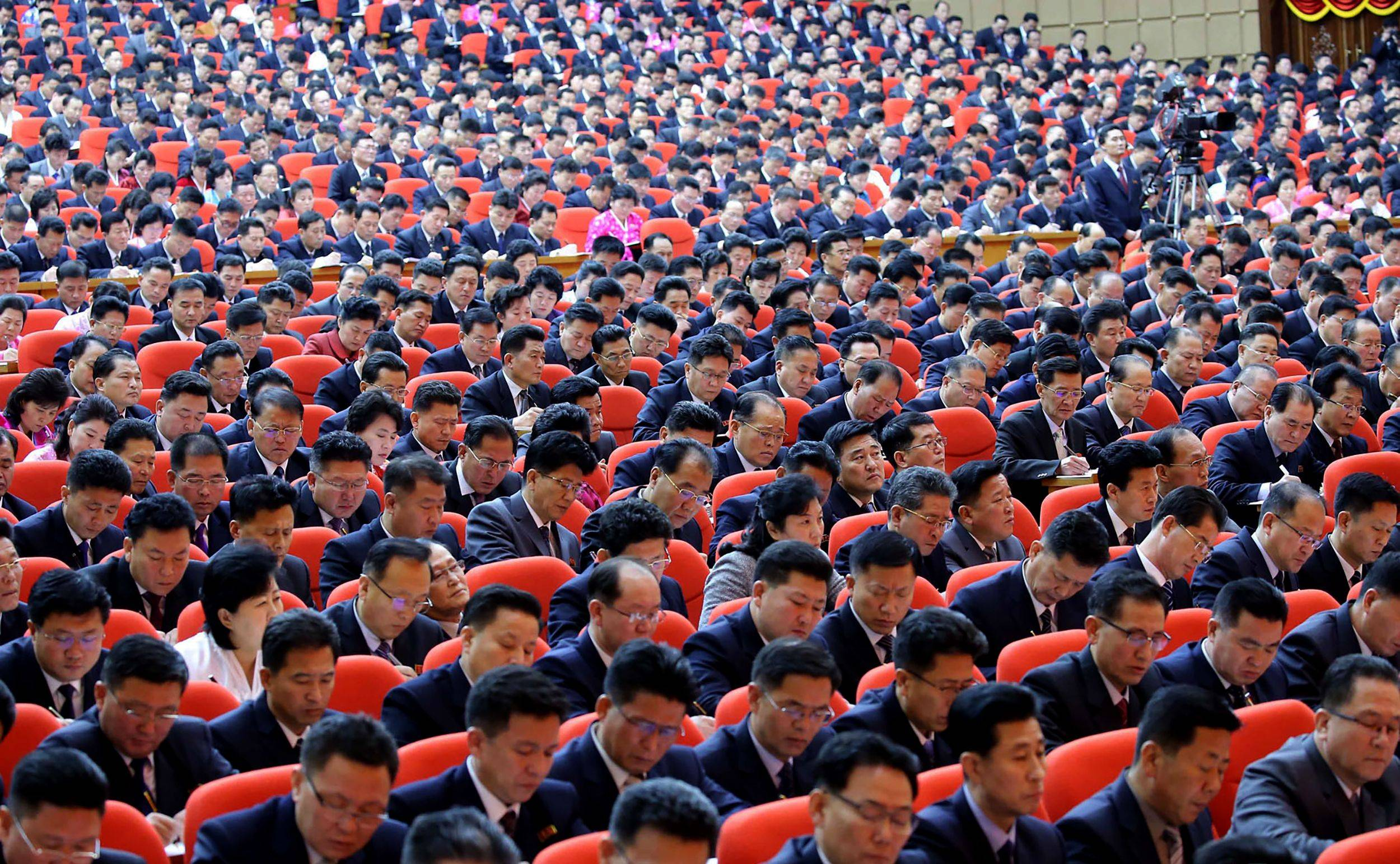 Attendees take notes during a ruling Workers' Party of Korea Congress in Pyongyang on Saturday. | KCNA / KNS / VIA AFP-JIJI