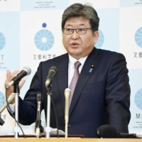 Education minister Koichi Hagiuda attends a news conference last week in Tokyo.  | KYODO