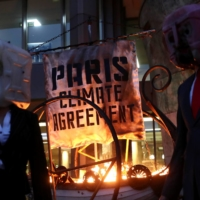 Ocean Rebellion protesters demonstrate outside the International Maritime Organisation headquarters in London in November. Britain and countries in the European Union in December committed to stronger emissions reductions targets for 2030. | REUTERS
