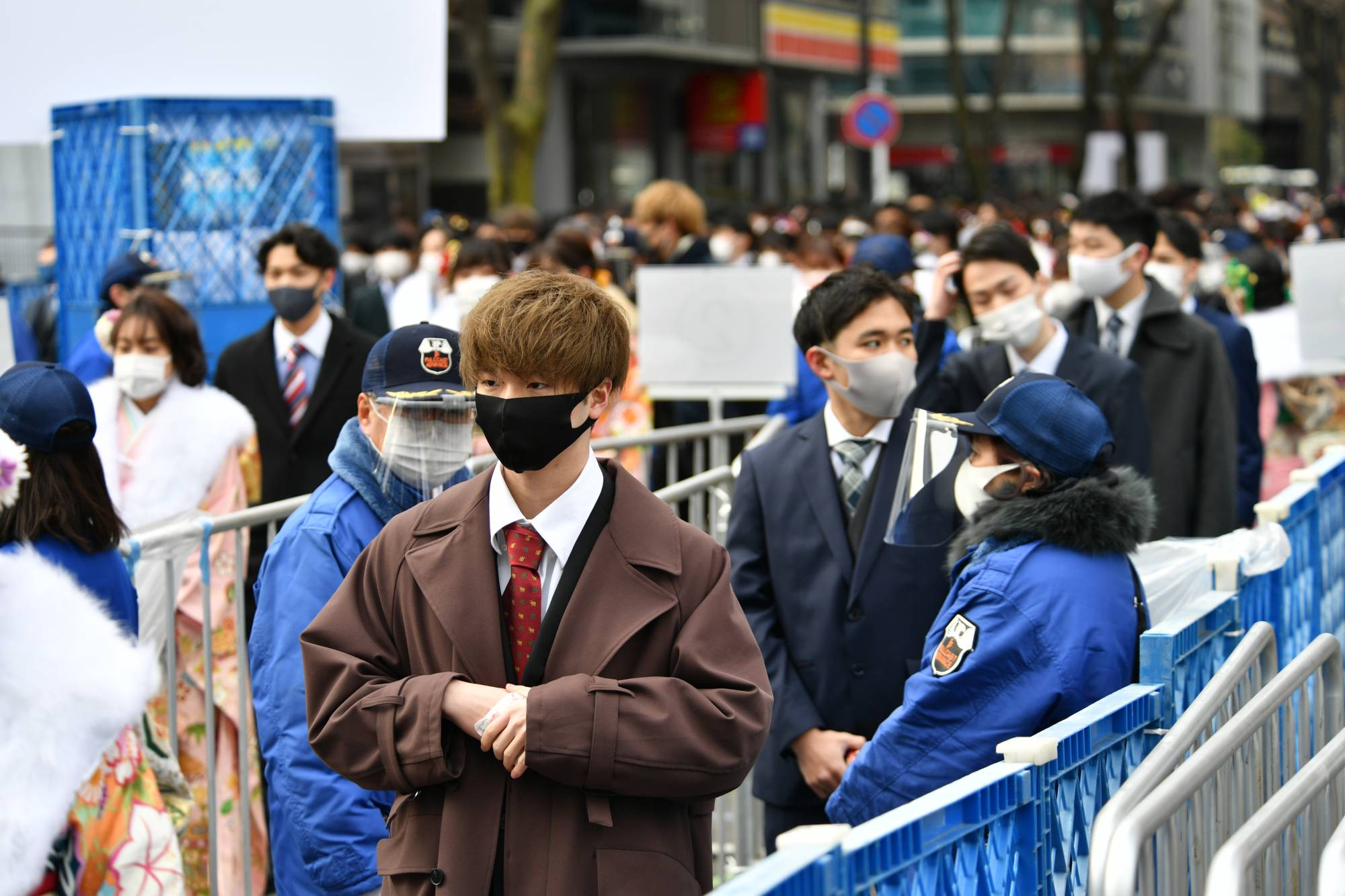 Attendees line up for a coming-of-age ceremony in Yokohama while maintaining distance according to recommendations. | RYUSEI TAKAHASHI